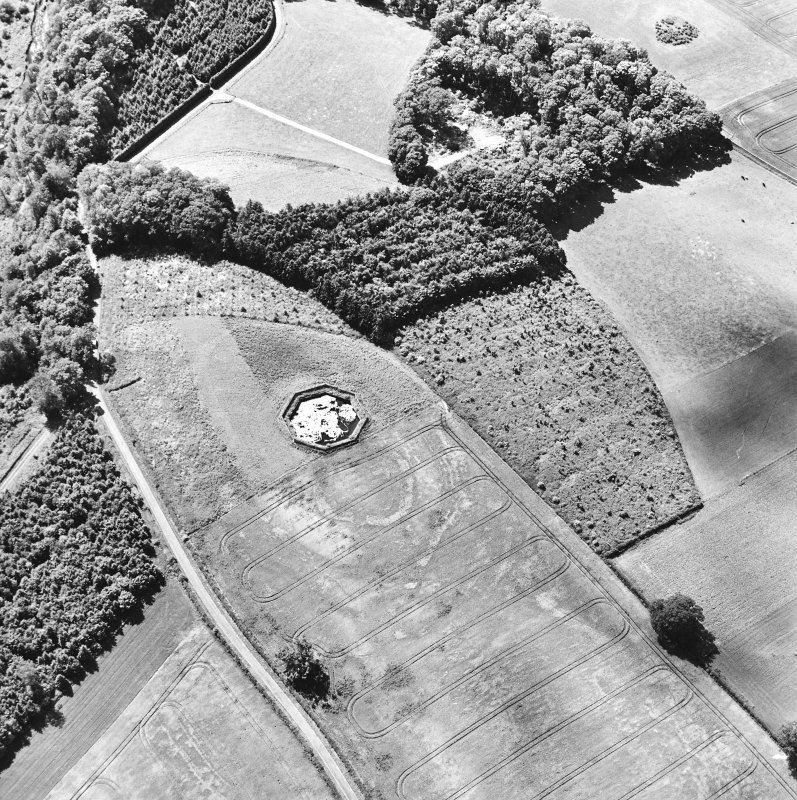 Brox Law, oblique aerial view, taken from N, centred on the cropmark of a fort which is partially overlain by a pond.
