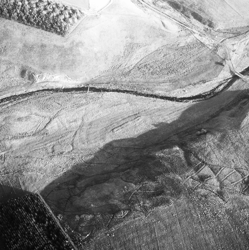 Birkcleuch, farming remains: oblique air photograph under conditions of shadow.