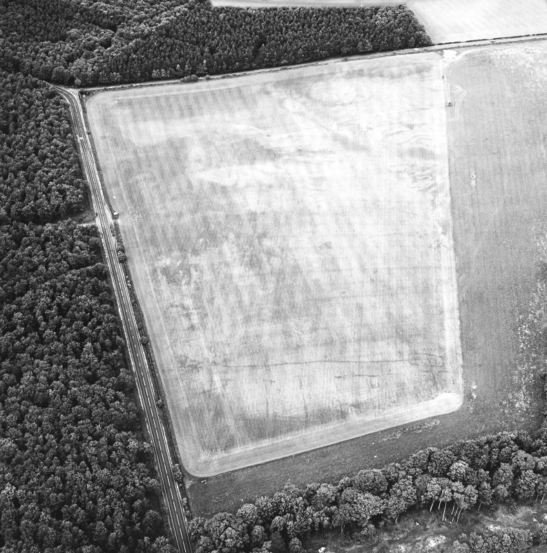Whitekirk, oblique aerial view, taken from the SSE, centred on cropmarks of a settlement. Further cropmarks are visible in the top half of the photograph.