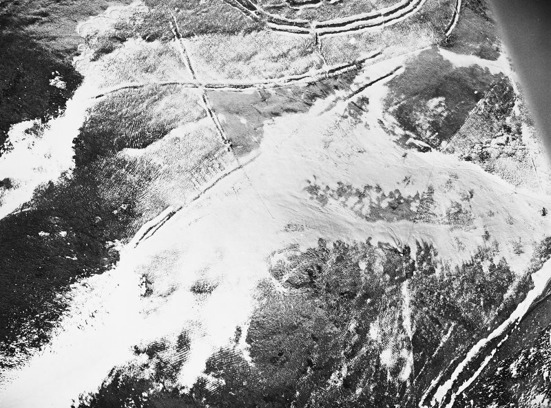 Woden Law, fort and associated monuments: air photograph under snow. RCAHMS, 1984.