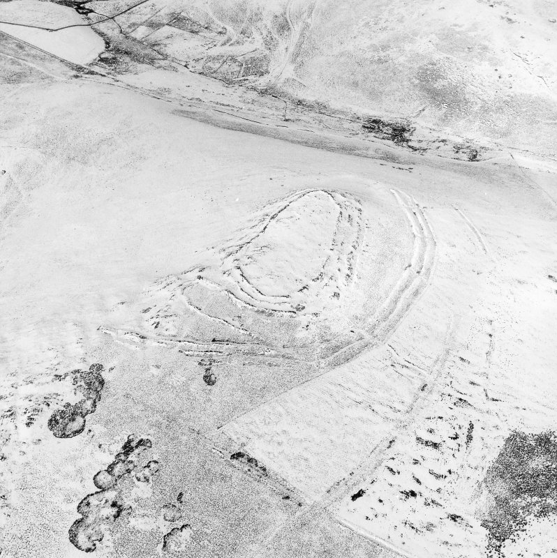 Woden Law, fort and associated monuments: air photograph under snow. RCAHMS, 1992.