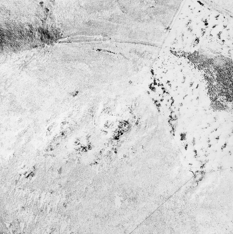 Woden Law, fort and associated monuments: air photograph under snow. RCAHMS, 1992. (Also shows Dere Street).