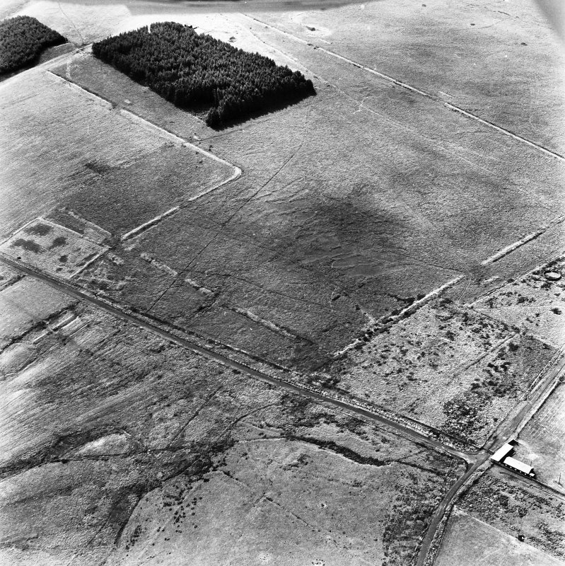 Pennymuir, oblique aerial view, taken from the NE, centred on two Roman Temporary Camps and a linear earthwork. An area of rig and the course of 'Dere Street' are visible in the bottom left-hand corner of the photograph.