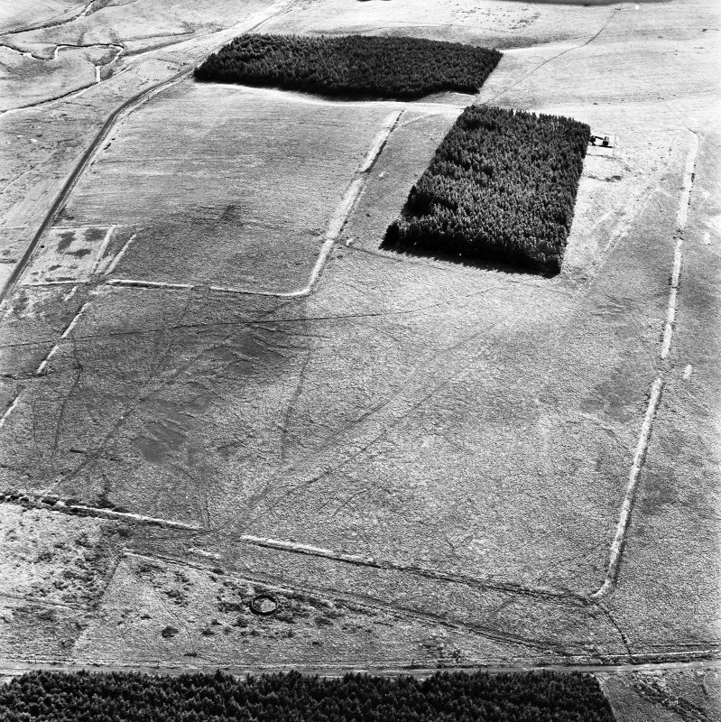 Pennymuir, oblique aerial view, taken from the NW, centred on two Roman Temporary Camps and a linear earthwork. The course of 'Dere Street' is visible in the top left-hand corner of the photograph.