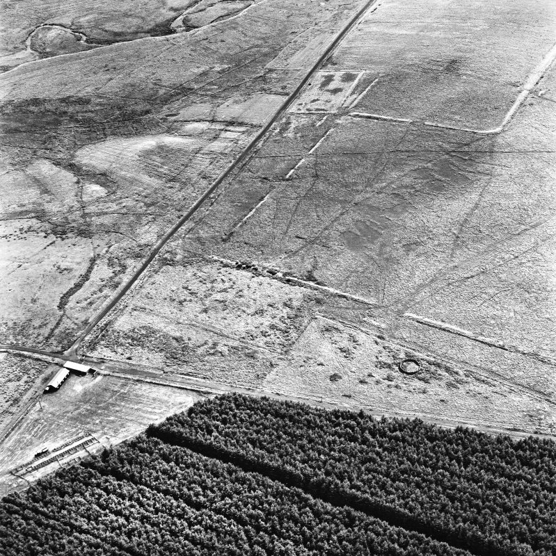 Pennymuir, oblique aerial view, taken from the NW, centred on three Roman Temporary Camps and an area of rig. The course of 'Dere Street' is shown in the left half of the photograph.
