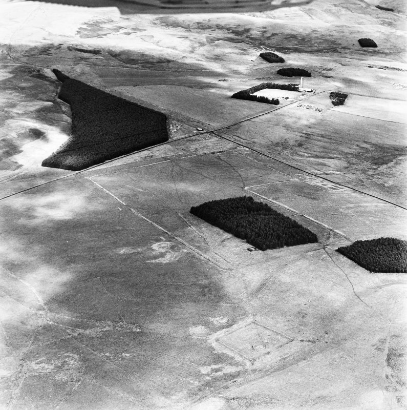 Pennymuir, oblique aerial view, taken from the SW, centred on Roman Temporary Camps and a linear earthwork. The course of 'Dere Street' is visible in the centre of the photograph.