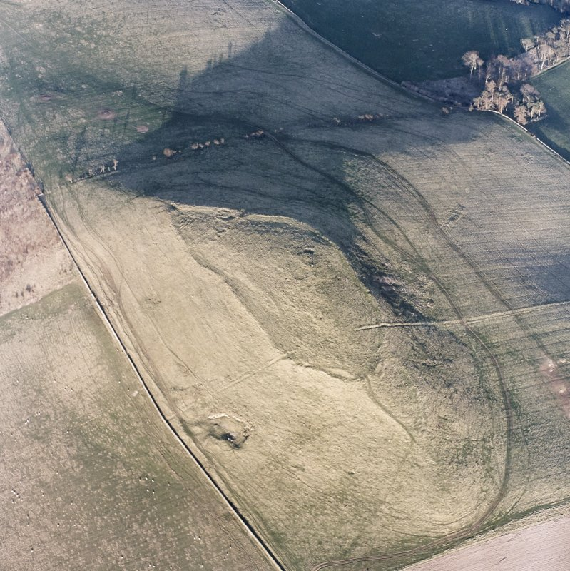 Oblique aerial view centred on the remains of the fort and settlement, taken from the WSW.