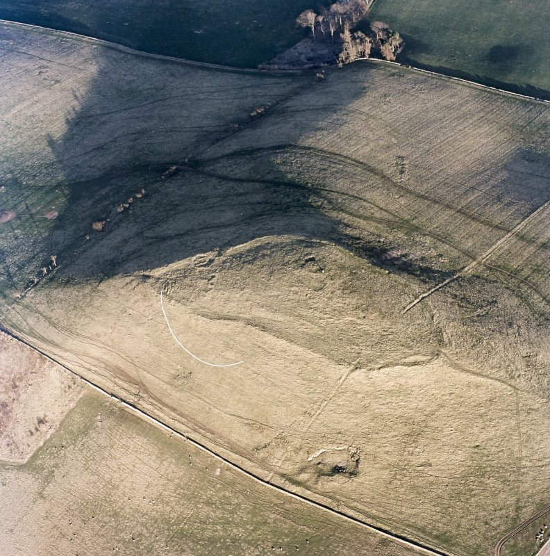 Oblique aerial view centred on the remains of the fort and settlement, taken from the WNW.