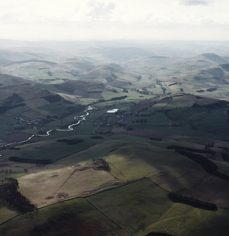 General oblique aerial view looking over the villages of Town Yetholm and Kirk Yetholm towards the Cheviots, taken from the NNW.