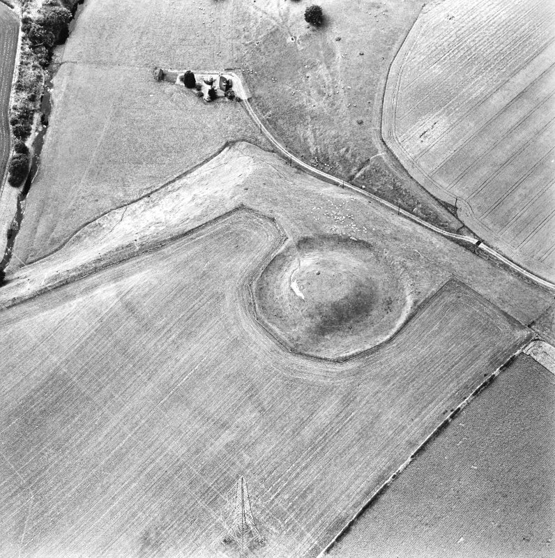 Oblique aerial view centred on the remains of the motte-and-bailey castle, taken from the ESE.