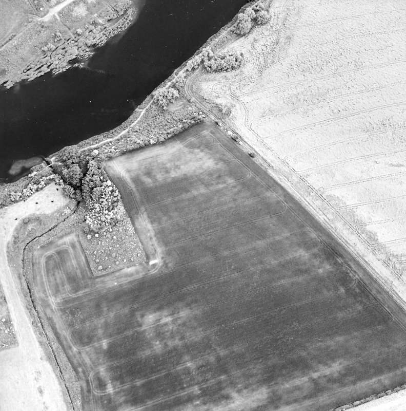 Oblique aerial view centred on the cropmarks of the deserted Medieval village, taken from the WNW.