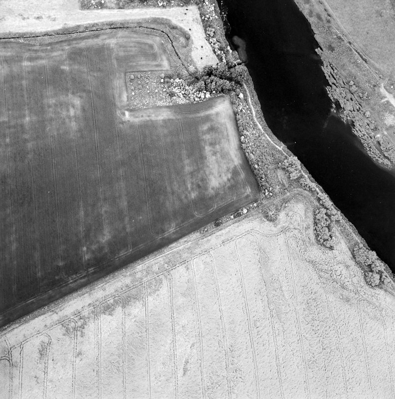 Oblique aerial view centred on the cropmarks of the deserted Medieval village, taken from the SSW.