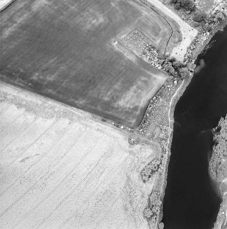 Oblique aerial view centred on the cropmarks of the deserted Medieval village, taken from the SE.