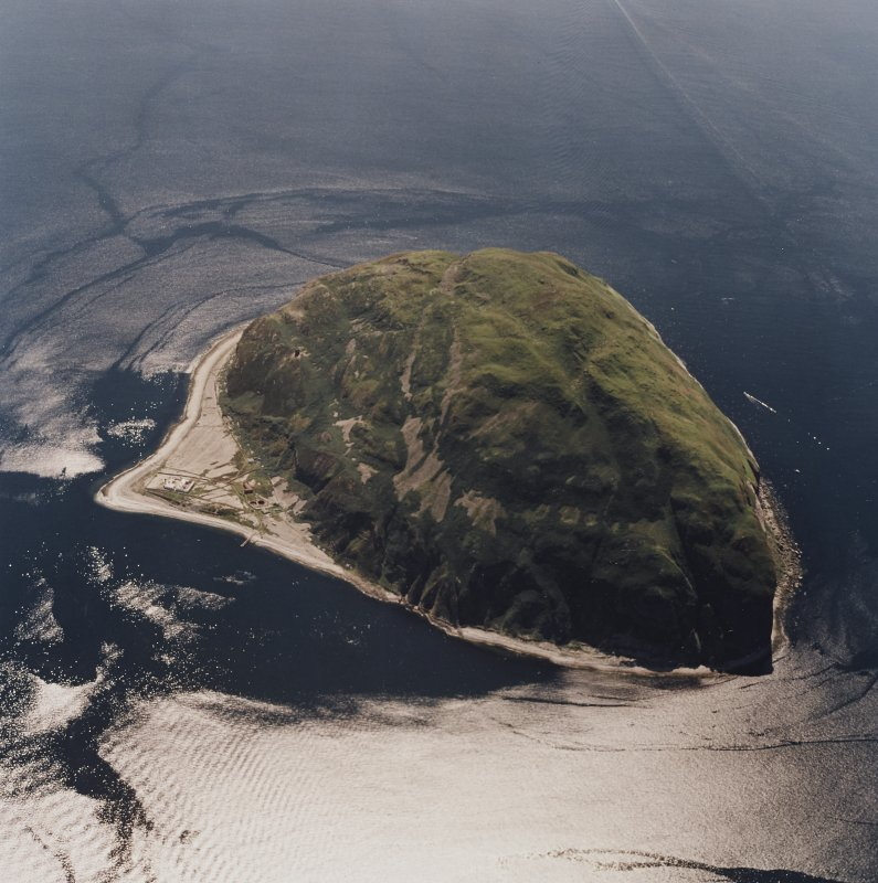 General oblique aerial view centred on Ailsa Craig, the lighthouse, cottages, foghorn and castle, taken from the N.