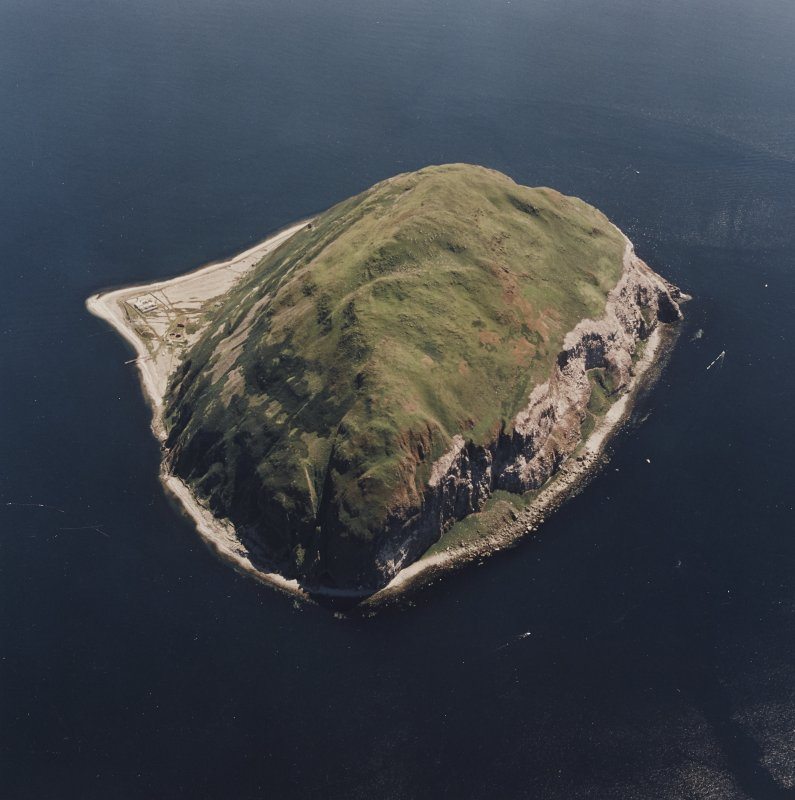 General oblique aerial view centred on Ailsa Craig, the lighthouse, cottages, foghorn and castle, taken from the NNW.