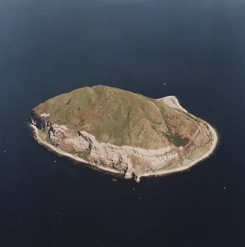 General oblique aerial view centred on Ailsa Craig, the lighthouse, cottages and foghorn taken from the WSW.
