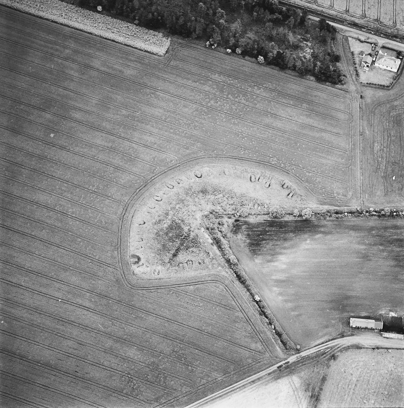 Oblique aerial view centred on the remains of feed bin stances, taken from the NE.