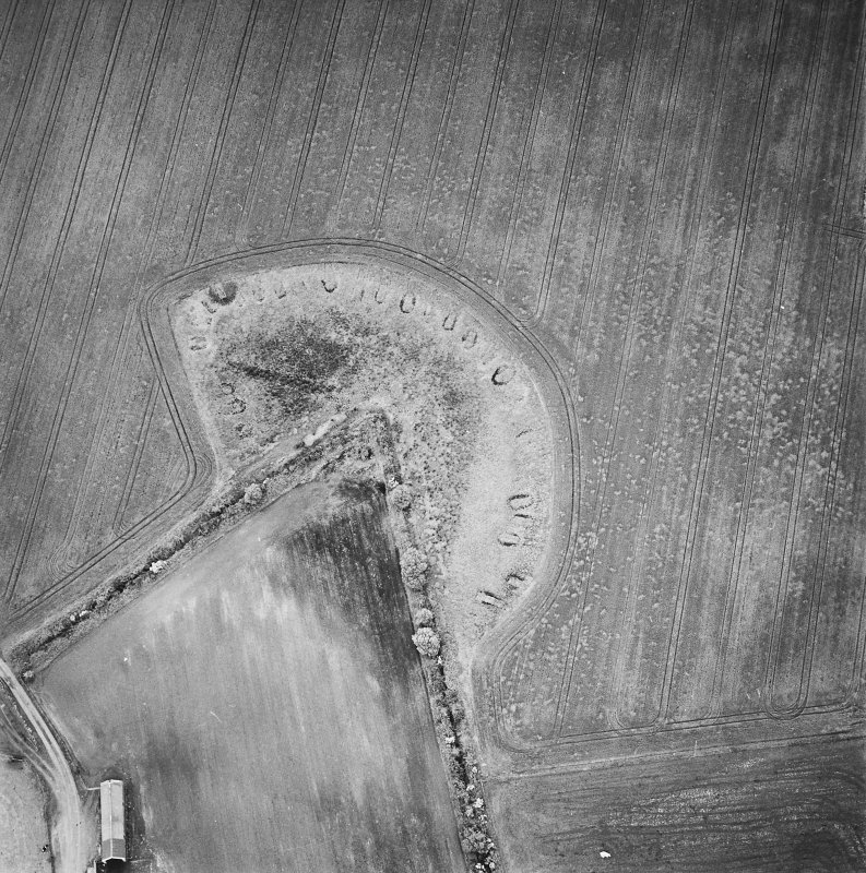Oblique aerial view centred on the remains of feed bin stances, taken from the SW.