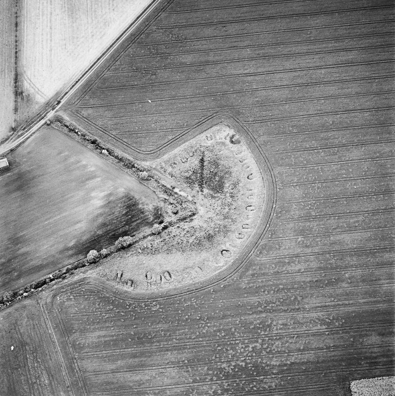 Oblique aerial view centred on the remains of feed bin stances, taken from the SSE.