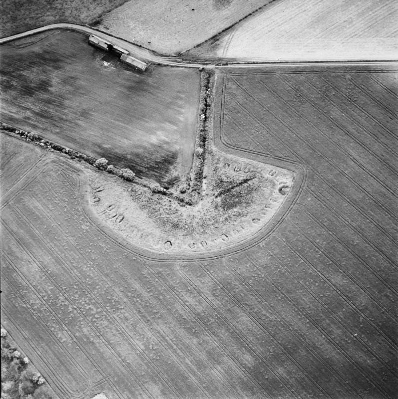Oblique aerial view centred on the remains of feed bin stances, taken from the ESE.