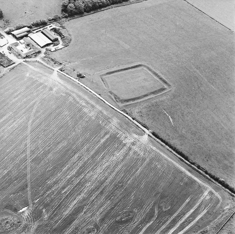 Oblique aerial view centred on the remains of the settlement, taken from the N.