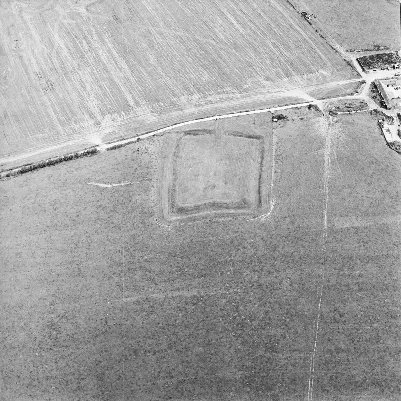 Oblique aerial view centred on the remains of the settlement, taken from the WSW.
