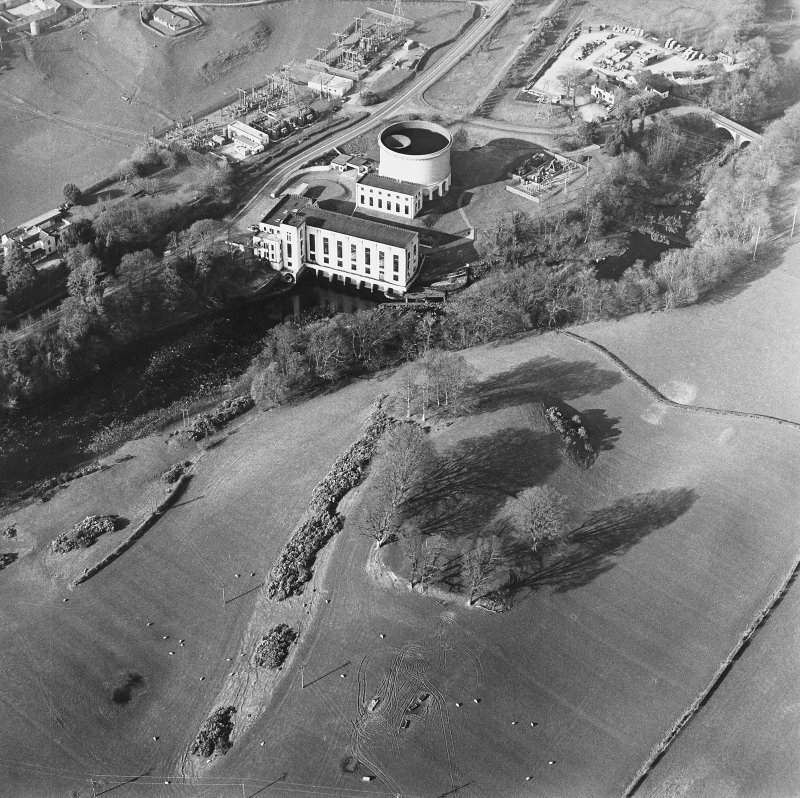 Oblique aerial view centred on the remains of the fort with the power station adjacent, taken from the S.