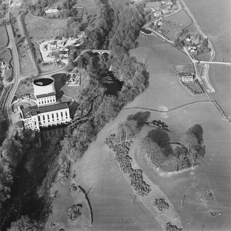 Oblique aerial view centred on the remains of the fort with the power station and road bridge adjacent, taken from the WSW.