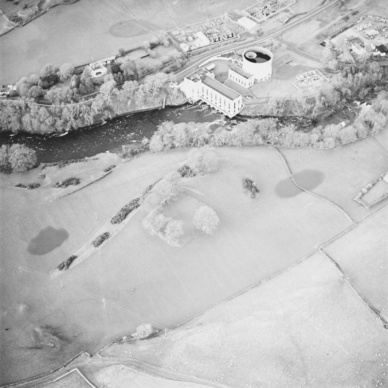 Oblique aerial view centred on the remains of the fort with power station adjacent, taken from the SSE.