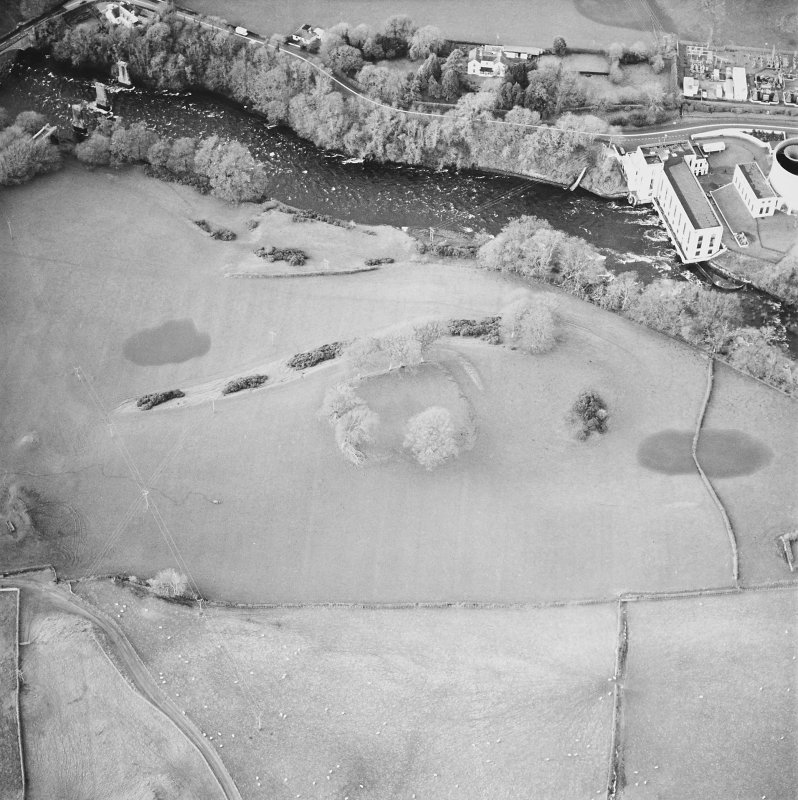 Oblique aerial view centred on the remains of the fort with power station adjacent, taken from the SE.