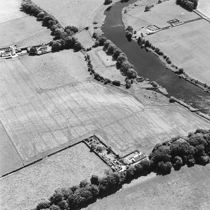 Oblique aerial view of Glenlochar, taken from N, centered on roman fort.