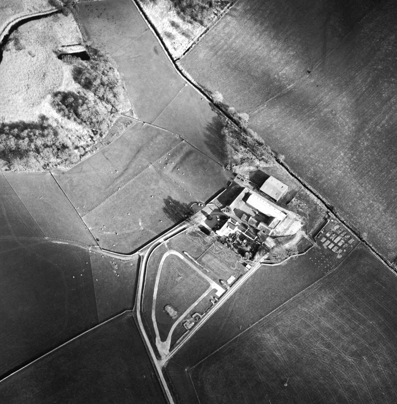Oblique aerial view centred on the remains of the moat with farmsteading adjacent, taken from the WNW.