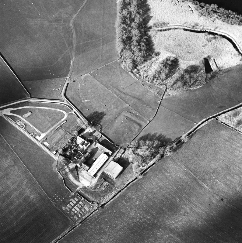 Oblique aerial view centred on the remains of the moat with farmsteading adjacent, taken from the SSW.