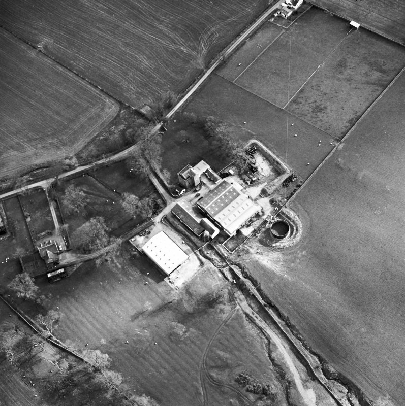 Oblique aerial view centred on the tower house with rig adjacent, taken from the NNE.