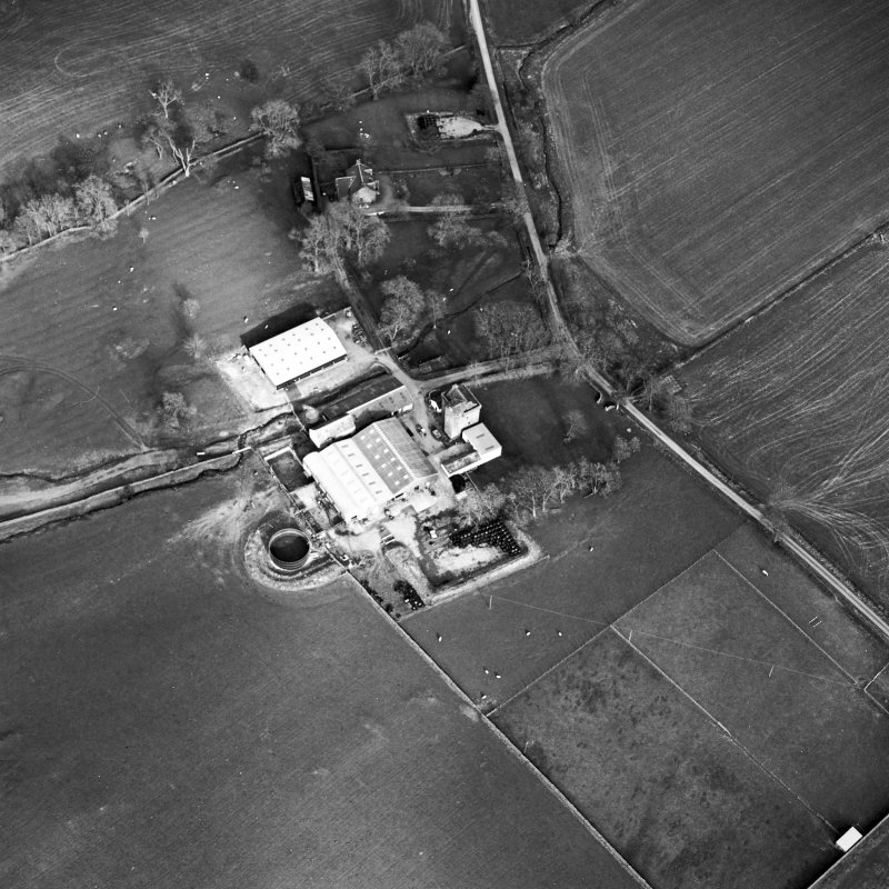Oblique aerial view centred on the tower house with rig adjacent, taken from the W.