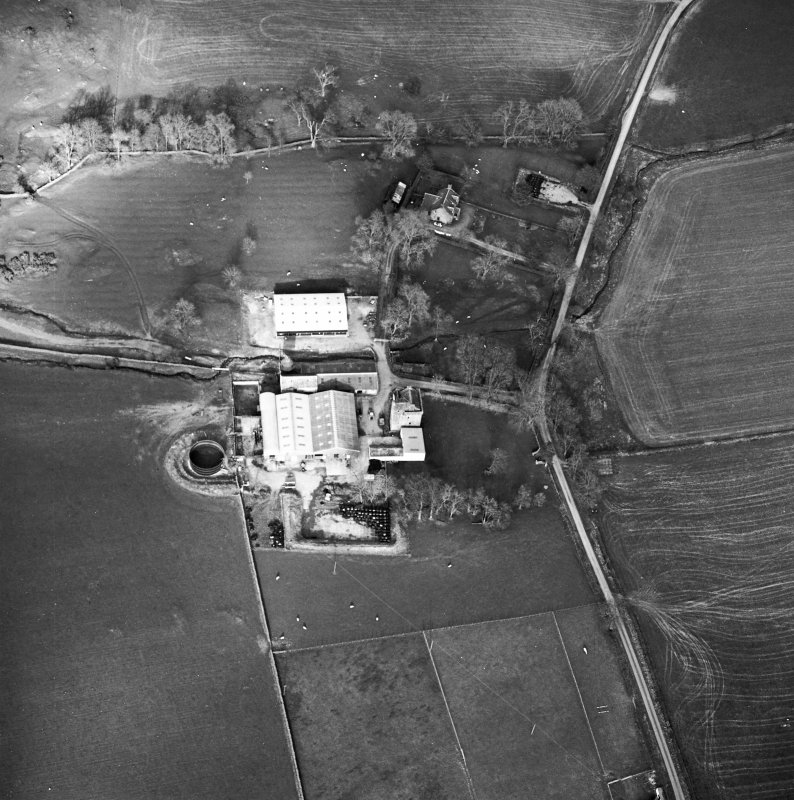 Oblique aerial view centred on the tower house with rig adjacent, taken from the WSW.