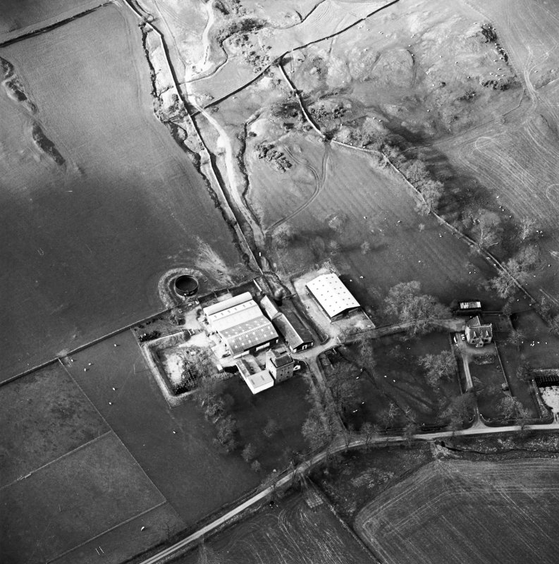 Oblique aerial view centred on the tower house with rig adjacent, taken from the SSE.