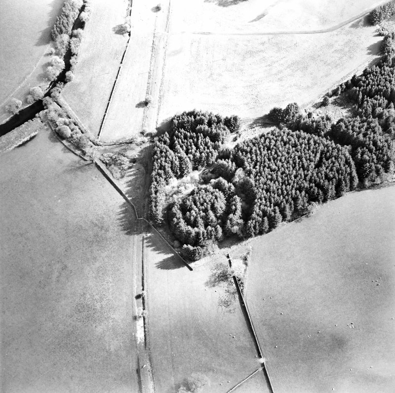 Oblique aerial view centred on the remains of the earthwork, taken from the N.