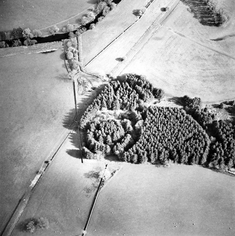 Oblique aerial view centred on the remains of the earthwork, taken from the NNW.