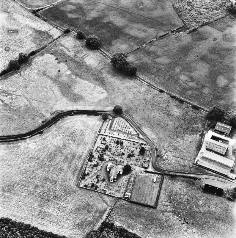 Holywood Abbey and Dalawoodie, oblique aerial view, taken from the N, centred on the cropmarks around the Abbey, and showing a rectilinear enclosure and linear cropmarks in the top half of the photogr ...