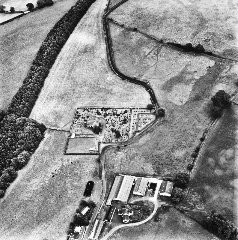 Holywood Abbey, oblique aerial view, taken from the WNW, centred on the cropmarks around the Abbey, and showing linear cropmarks in the top right-hand corner of the photograph.