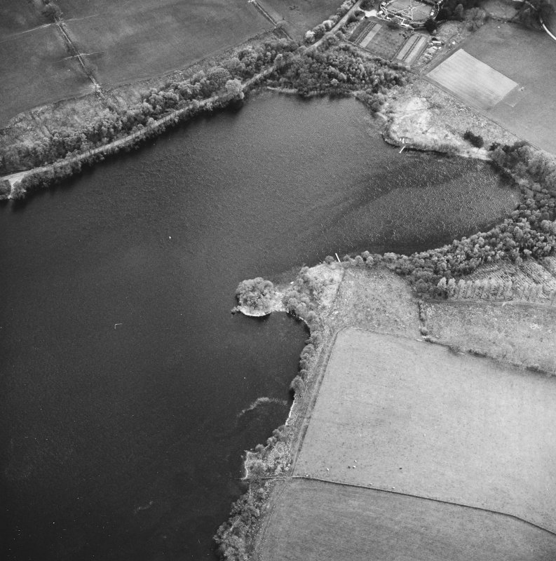 Oblique aerial view centred on the remains of the crannog, taken from the NE.