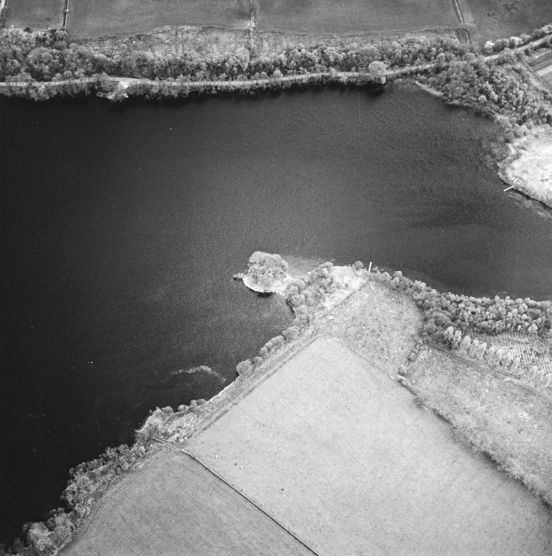 Oblique aerial view centred on the remains of the crannog, taken from the NNE.