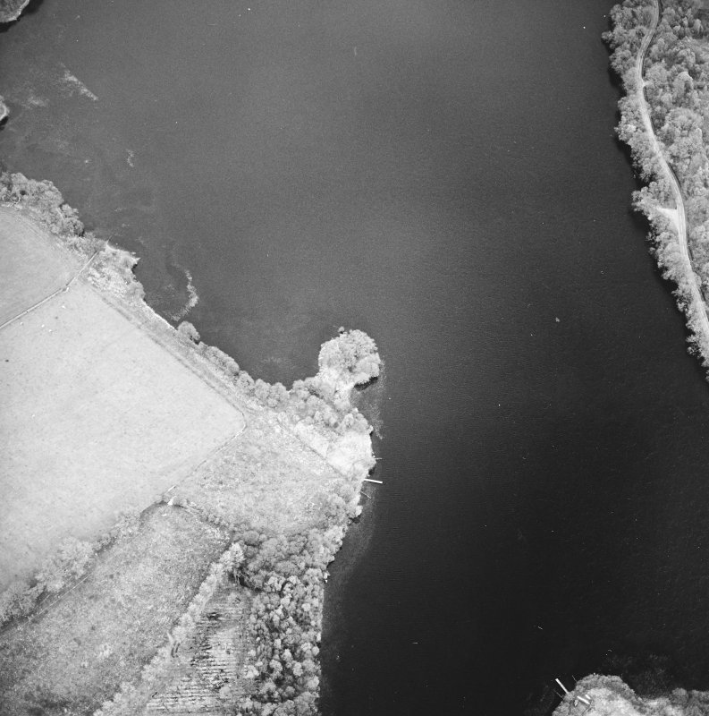 Oblique aerial view centred on the remains of the crannog, taken from the WNW.