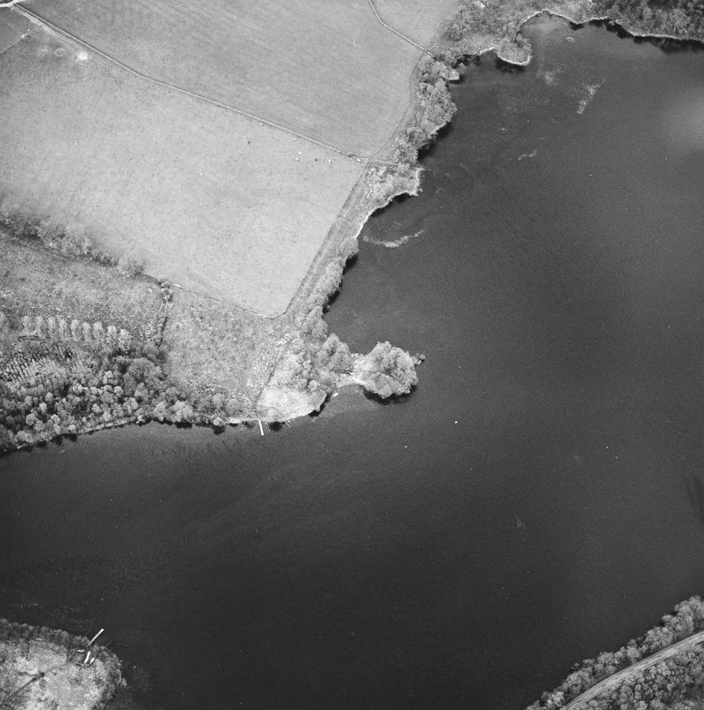 Oblique aerial view centred on the remains of the crannog, taken from the SW.