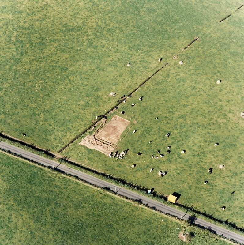 Oblique aerial view of The Twelve Apostles centred on the excavation of the stone circle, taken from the SSW.
