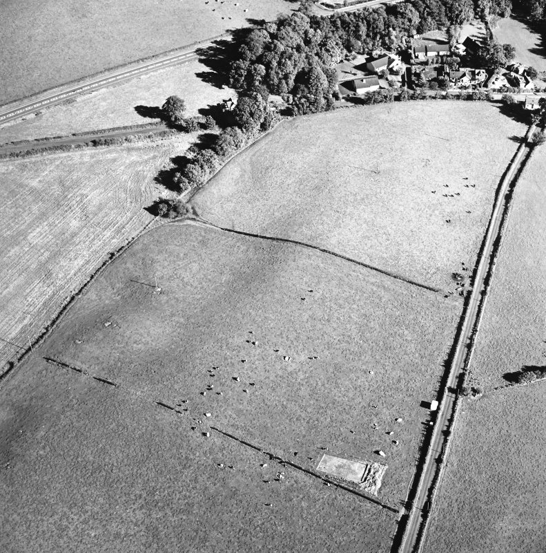 Oblique aerial view of The Twelve Apostles centred on the excavation of the stone circle, taken from the NW.