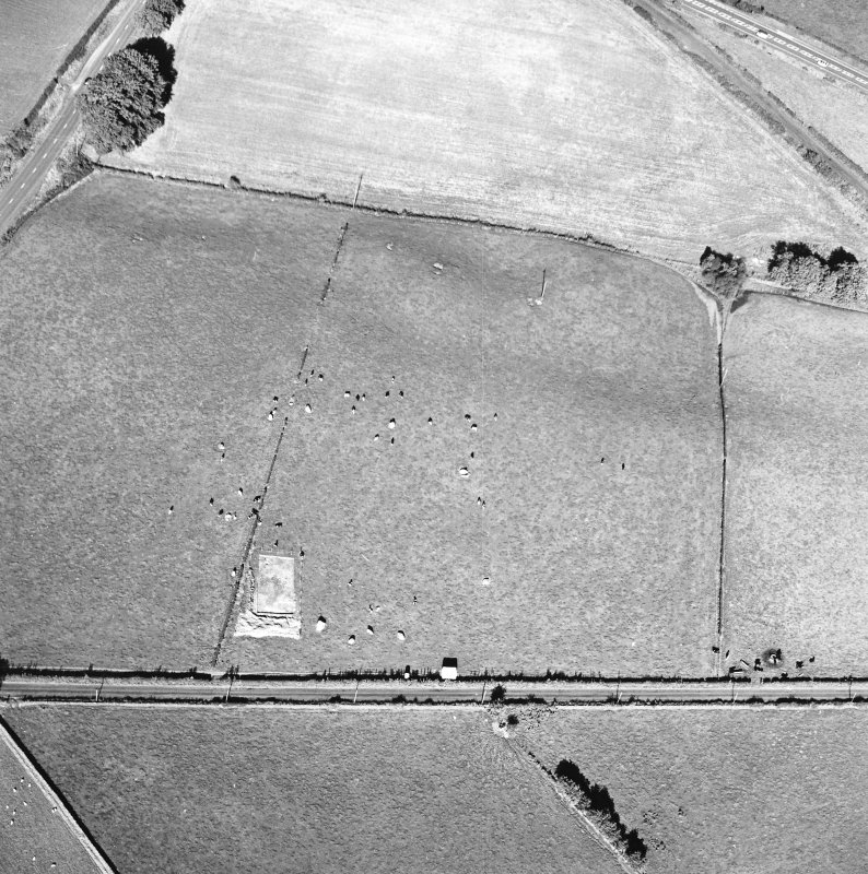 Oblique aerial view of The Twelve Apostles centred on the excavation of the stone circle, taken from the SW.