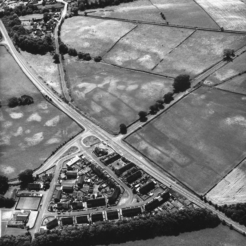 Holywood and Kilncroft, oblique aerial view, taken from the NNE, centred on the southern cursus monument and surrounding cropmarks. Further linear cropmarks are visible in the left centre of the photograph, and the 12 Apostles stone circle appears in the top right-hand corner.