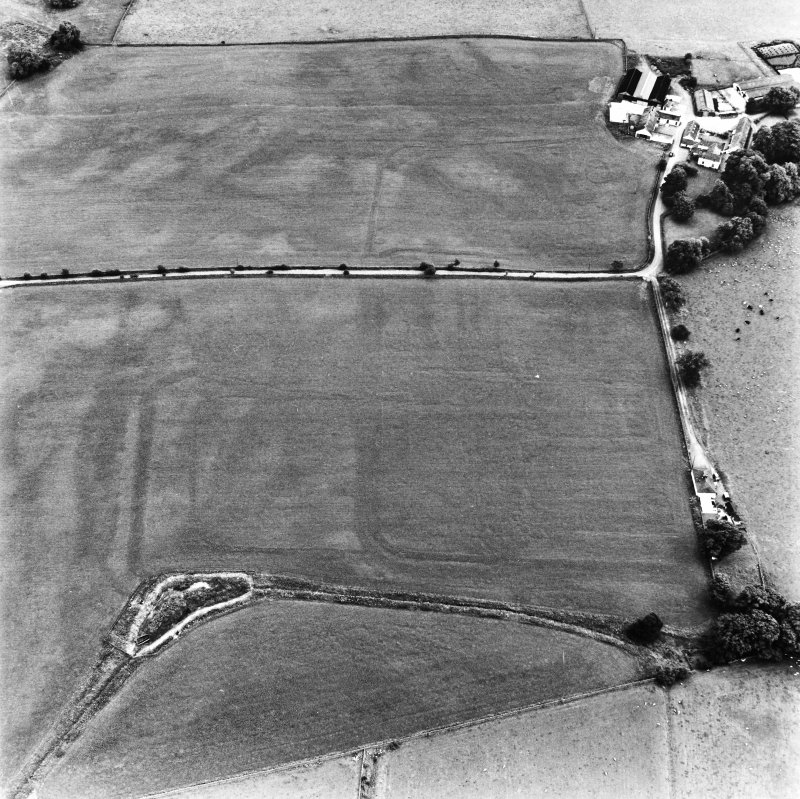 Bankhead, Dalswinton, oblique aerial view, taken from the NNW, centred on the cropmarks of Roman Forts and an oval enclosure.